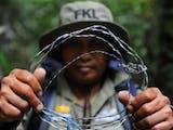 Gambar sampul Menghancurkan Perangkap Satwa Liar di Leuser, Kawasan Konservasi Paling Penting di Muka Bumi