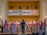 Gambar sampul Membawakan Lagu Tradisional, Paduan Suara Universitas ini Juara di Austria