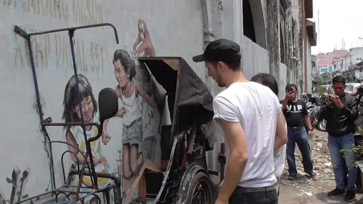 Lukisan Orangutan di Jalan-jalan Menjadi Ikon Baru Kota Ini
